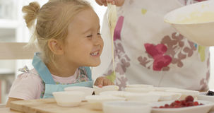 Happy little girl with empty muffin holders Stock Photography