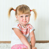 Happy little  girl engaged in physical activity Stock Photo