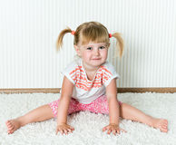 Happy little  girl engaged in physical activity Royalty Free Stock Photography