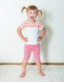 Happy little girl engaged in physical activity royalty free stock images