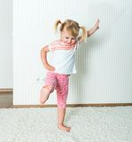 Happy little  girl engaged in physical activity Stock Photography