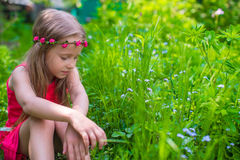 Happy little girl enjoy summer day in the garden Royalty Free Stock Photo