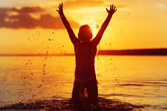 Happy little girl enjoying holiday beach vacation. Stock Photography