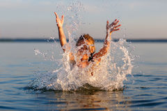 Happy little girl enjoying holiday beach vacation. Stock Photos