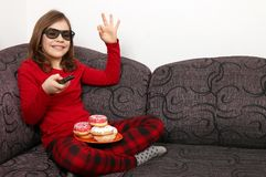 Little girl enjoys a television show Stock Photography