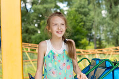 Happy little girl at the fairground Stock Photography