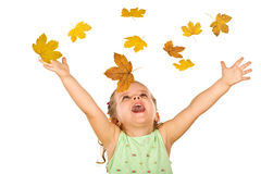 Happy little girl with falling autumn leaves. Happy shouting little girl welcoming the falling autumn leaves - isolated, without motion blur stock images