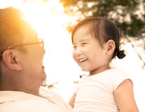 Happy little girl with father Royalty Free Stock Image