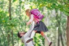 Happy little girl and father stock images