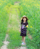 Happy little girl in a field Stock Photo