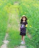 happy little girl in a field Stock Photo