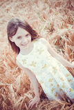 Happy little girl in the field Royalty Free Stock Photography
