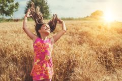 Happy little girl in a field of ripe wheat royalty free stock photos