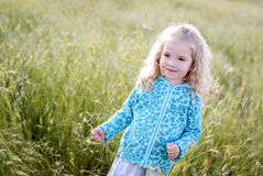 Happy little girl in the field Stock Image