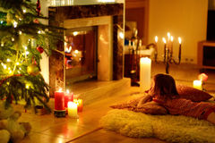 Happy little girl by a fireplace on Christmas Royalty Free Stock Photo