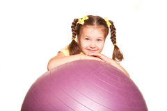 Happy little girl with fit ball. Stock Photos