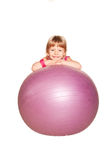 Happy little girl with fitness ball. Isolated on white Royalty Free Stock Photography