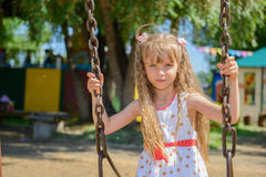 Happy little girl five years old wearing summer dress having fun Royalty Free Stock Photos