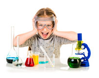 Happy little girl with flasks for chemistry Royalty Free Stock Photos