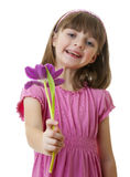 Happy little girl with a flower Royalty Free Stock Photography