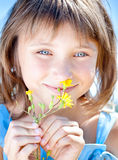 Happy little girl with a flower in his hand Royalty Free Stock Photos
