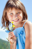Happy little girl with a flower in his hand Royalty Free Stock Photography