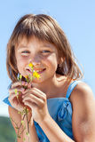 Happy little girl with a flower in his hand Royalty Free Stock Photo