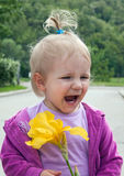 Happy little girl with flower Royalty Free Stock Photo