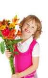 Happy   little  girl  with flowers. Royalty Free Stock Photography