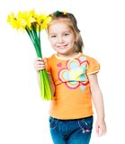 Happy little girl with flowers Royalty Free Stock Image