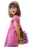 Happy little girl with a flowers Royalty Free Stock Photography