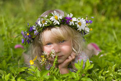 Happy little girl in flowers wreath Royalty Free Stock Image