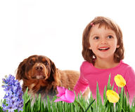 Happy little girl four years old and spring flower Stock Photo