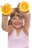 Happy little girl with fresh orange Stock Images