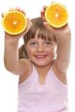 Happy little girl with fresh orange Stock Images