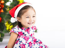 Happy little girl   in front of  christmas tree Royalty Free Stock Image