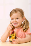 Happy little girl with fruit salad Stock Image