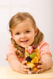 Happy little girl with fruity refreshment. Healthy diet concept stock photo