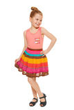 Happy little girl full lenght in colorful skirt, isolated on white background Royalty Free Stock Photography