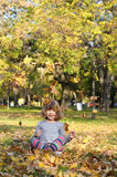 Happy little girl fun with autumn leaves Royalty Free Stock Photo