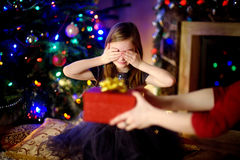 Free Happy Little Girl Getting A Christmas Gift From Her Mommy Royalty Free Stock Photos - 78975748