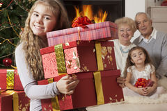 Happy little girl getting Christmas presents Stock Photo