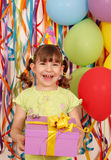 Happy little girl with gift birthday Stock Photography
