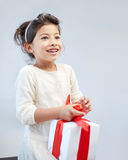 Happy little girl with gift box at home Stock Photo