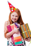 Happy little girl with gift box over white background Royalty Free Stock Photo