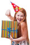 Happy little girl with gift box over white background Stock Image