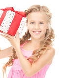 Happy little girl with gift box Royalty Free Stock Photo