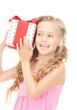 Happy little girl with gift box Stock Image