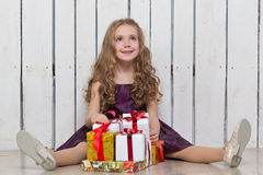 Happy little girl with gift boxes Royalty Free Stock Image