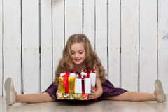 Happy little girl with gift boxes Royalty Free Stock Photos